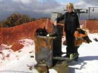 Deborah Boon at what's left of the oven, after the fire burnt the lodge to the ground
